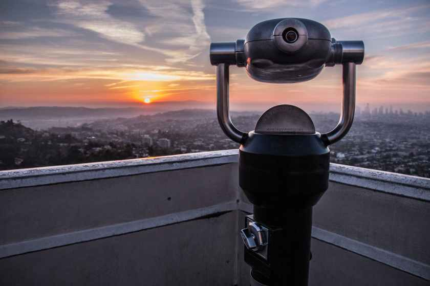 coin operated tower viewer on rooftop during sunset