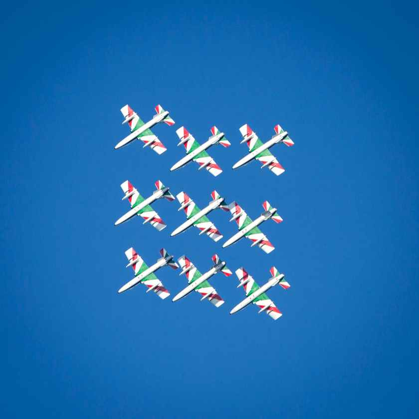 green and white show planes on sky